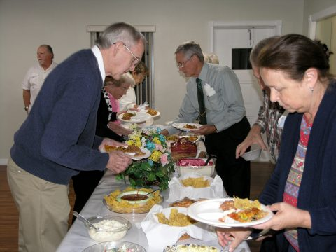 Digging in at the fellowship meal.