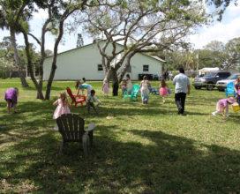 Children hunt for eggs at the church egg hunt