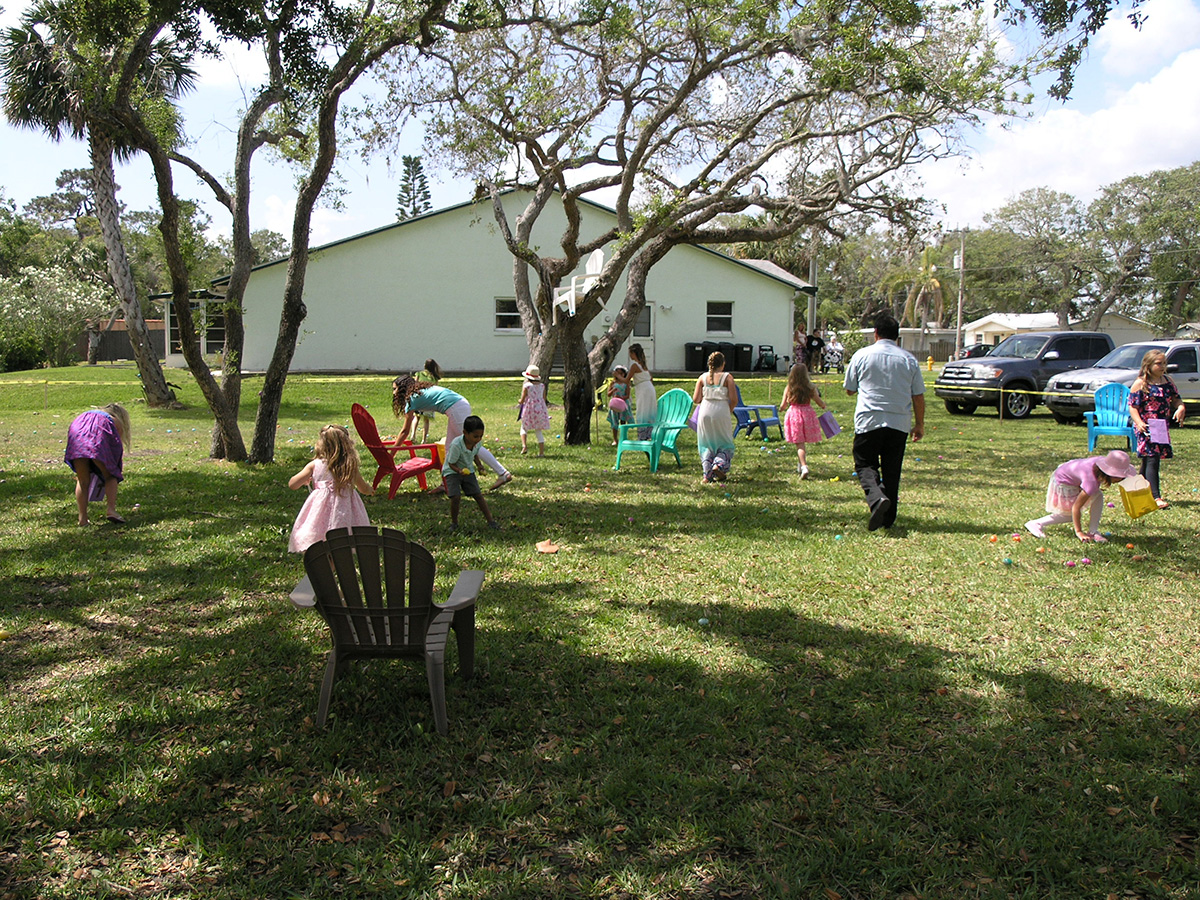 Children hunt for eggs at the church egg hunt