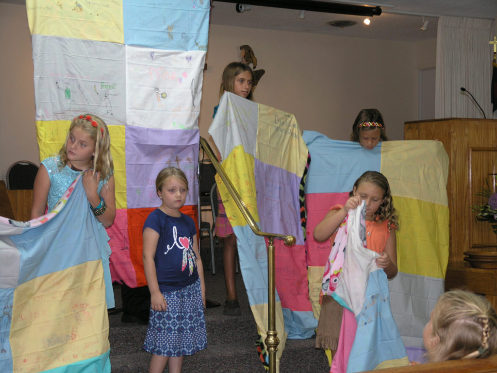 kids with quilts