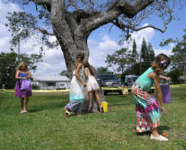 Girls hunt for resurrection eggs at Beachside Baptist Church