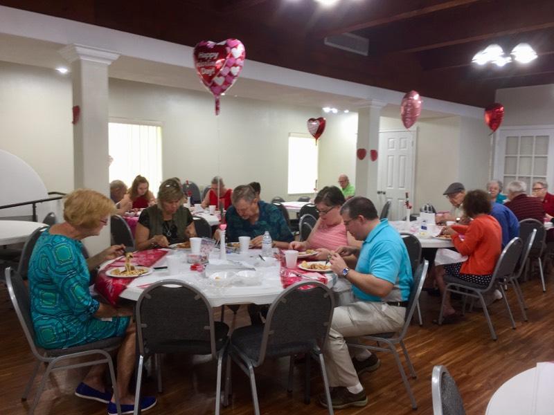 New Smyrna Beach church enjoying fellowship meal