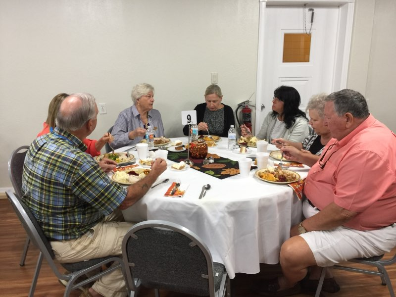 Eating together at Thanksgiving church meal